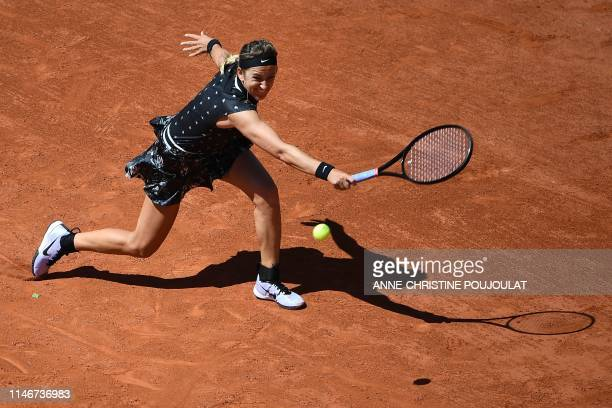 TOPSHOT Belarus' Victoria Azarenka plays a backhand return to Latvia's Jelena Ostapenko during their women's singles first round match on day three...