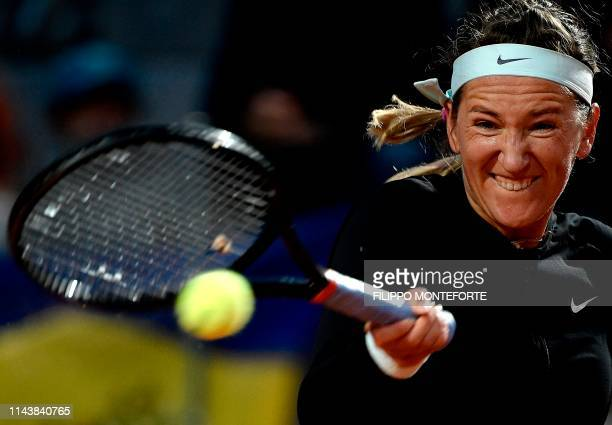 TOPSHOT Belarus' Victoria Azarenka plays a forehand return to Ukraine's Elina Svitolina during their WTA Masters tournament tennis match in Rome at...