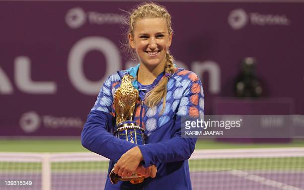 Belarus' Victoria Azarenka poses with the trophy after beating Samantha Stosur of Australia in their Qatar WTA Tennis Open final tennis match in Doha...