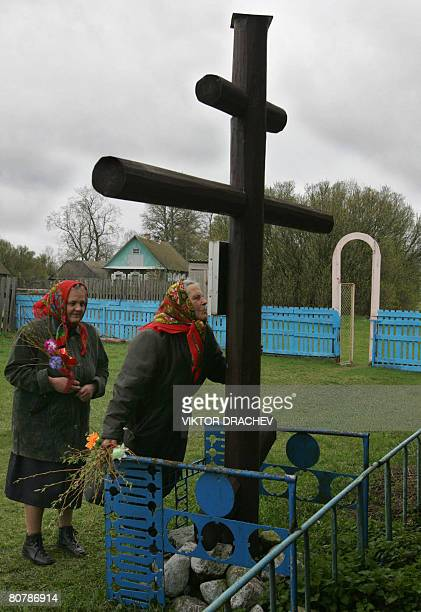 Belarus' villagers kiss a cross in their village of Zabashevichi 120 kilometers north from Minsk on April 20 during Palm Sunday celebrations AFP...