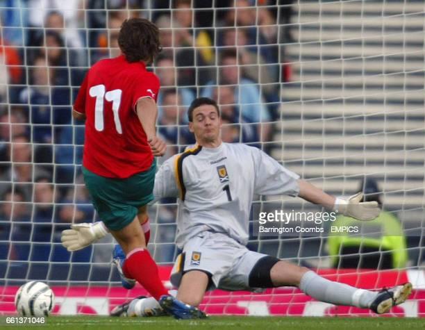 Belarus' Vitali Kutuzov scores the opening goal past Scotland's goalkeeper Craig Gordon
