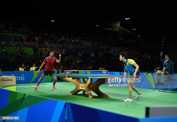 Belarus' Vladimir Samsonov celebrates after a point against Japan's Jun Mizutani in their men's singles bronze medal table tennis match at the...