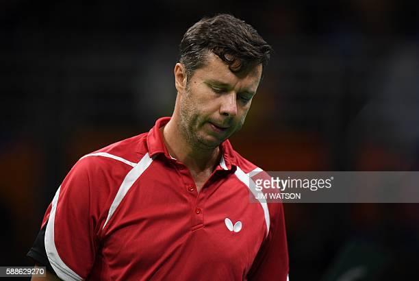 Belarus' Vladimir Samsonov reacts after a point against Japan's Jun Mizutani in their men's singles bronze medal table tennis match at the Riocentro...