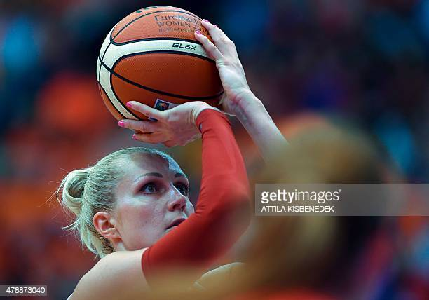 Belarus' Yelena Leuchanka aims to score during the bronze basketball match between Spain and Belarus of the EuroBasket Women 2015 tournament in...