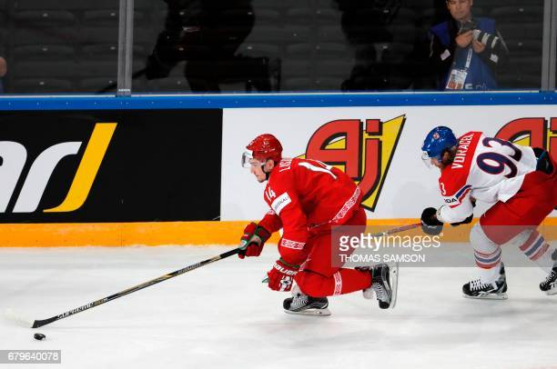 Belarus' Yevgeni Lisovets controls the puck during the IIHF Men's World Championship group B ice hockey match between Belarus and Czech Republic in...