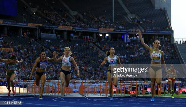 Belarusian athlete Alina Talay competes in women's 100m hurdle race semi final during the fourth day of the 2018 European Athletics Championships in...