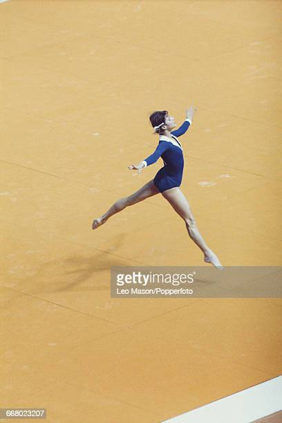 Belarusian gymnast Olga Korbut, competing for the Soviet Union, pictured in action during competition in the floor exercise, part of the women's...