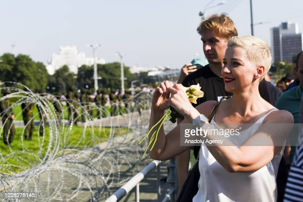 Belarusian musician and political activist Maria Kolesnikova is seen in front of the security forces standing guard to block protestors to reach the...