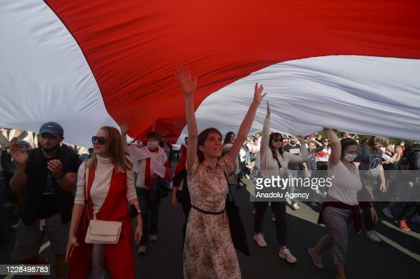 Belarusian opposition supporters march during a rally against presidential election results, in central Minsk, Belarus on September 13, 2020. The...