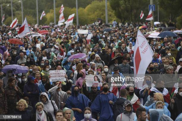 Belarusian opposition supporters take part in a rally against presidential election results as they march from Nemiga Avenue to Stella Square in...