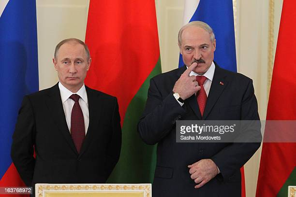 Belarusian President Alexander Lukashenko and Russian President Vladimir Putin attend a meeting at Konstantinovsky Palace on March 15, 2013 in Saint...