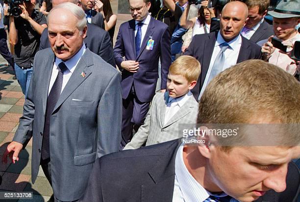 Belarusian President Alexander Lukashenko, center, with his son Nikolai arrives to attend the inauguration ceremony of Petro Poroshenko as Ukraine's...