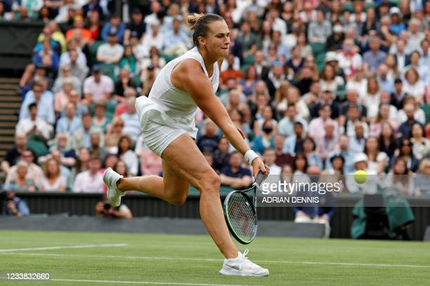 Belarus's Aryna Sabalenka returns against Tunisia's Ons Jabeur during their women's quarter-final tennis match on the eighth day of the 2021...