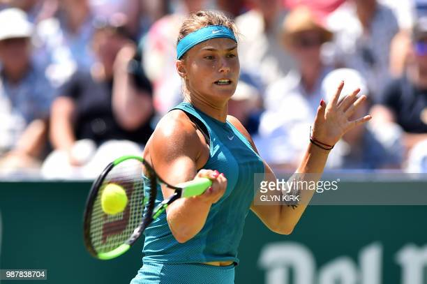 Belarus's Aryna Sabalenka returns to Denmark's Caroline Wozniacki during their Women's singles finals match at the ATP Nature Valley International...