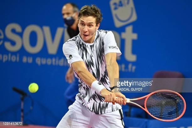 Belarus's Egor Gerasimov returns the ball to Belgium's David Goffin during their singles semi-final tennis match at the Open Sud de France ATP World...
