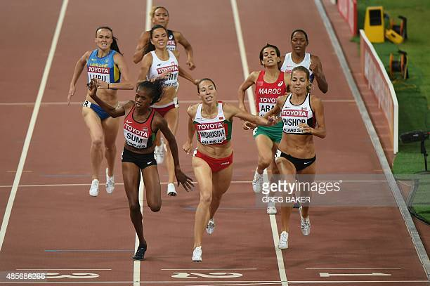 Belarus's Marina Arzamasova races for the line to win ahead of second placed Canada's Melissa Bishop and third placed Kenya's Eunice Jepkoech Sum...