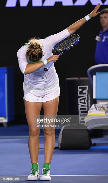 Belarus's Victoria Azarenka bows as she celebrates after victory in her women's singles match against Belgium's Alison Van Uytvanck on day two of the...