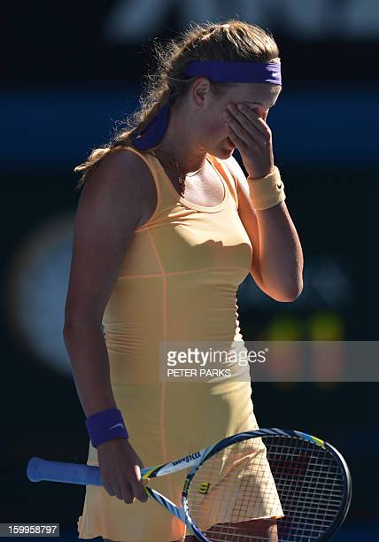 Belarus's Victoria Azarenka reacts after a point against Sloane Stephens of the US during their women's singles semifinal match on day 11 of the...