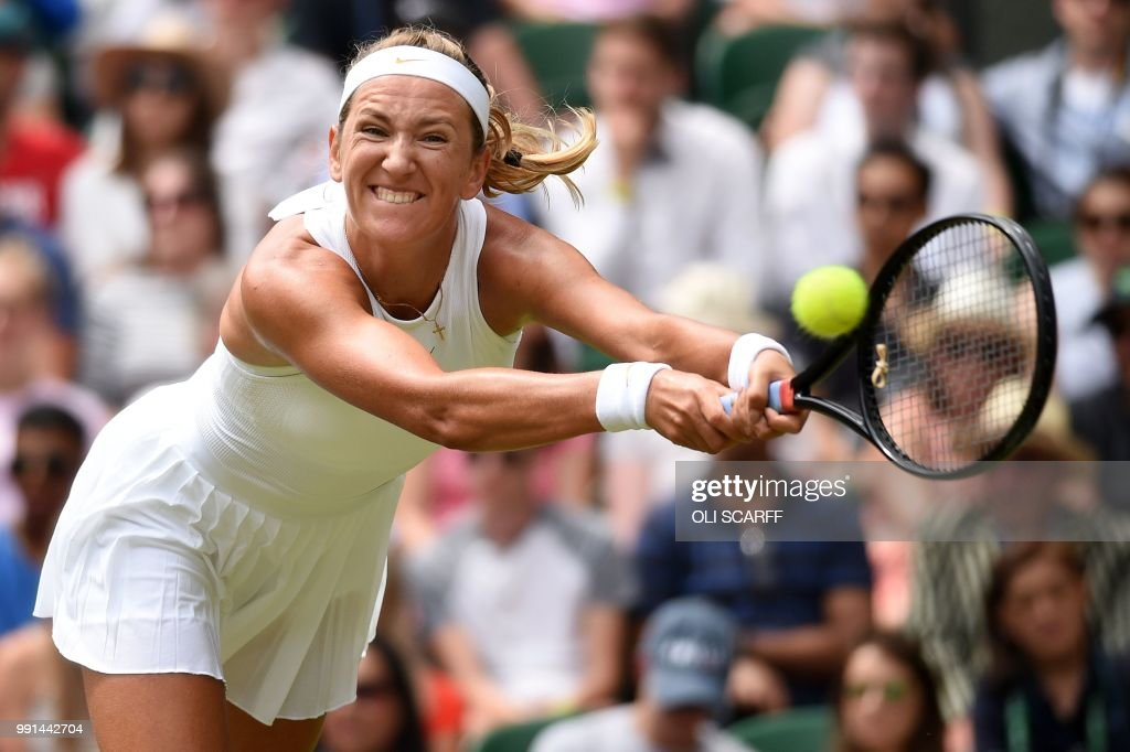 Belarus's Victoria Azarenka returns against Czech Republic's Karolina Pliskova during their women's singles second round match on the third day of the 2018 Wimbledon Championships at The All England Lawn Tennis Club in Wimbledon, southwest London, on July 4, 2018. (Photo by Oli SCARFF / AFP) / RESTRICTED