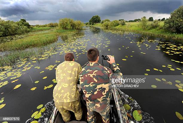 Belarussian game wardens search for poachers fishing on the Pripyat river 350km southeast of Minsk near the village Konotop on August 10 2009 a mere...