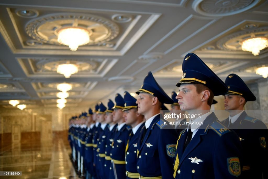 Belarussian honor guards wait on August 26, 2014 before the start of a summit with Russian President Vladimir Putin, his Ukrainian President Petro Poroshenko and EU foreign policy chief Catherine Ashton in the Belarussian capital Minsk. Putin and Poroshenko are meeting in Minsk for key talks, after the US warned of a 'significant escalation' in the crisis over Ukraine and Kiev announced the capture of 10 Russian paratroopers.