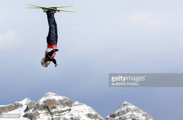 Belarussian Oly Slivets jumps during the women's aerials final of the Freestyle World Championship in Madonna di Campiglio 10 March 2007 Chinese Nina...
