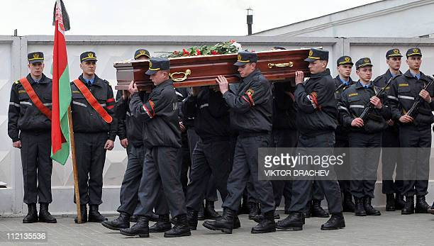 Belarussian policemen carry the coffin of Galina Pikulik a victim of the Minsk metro bombing that killed 12 and wounded 200 on April 11 during a...