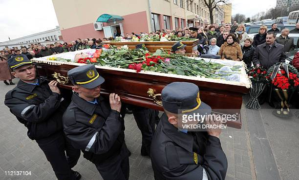 Belarussian policemen carry the coffins of Galina Pikulik and Anatoliy Narkevich victims of the Minsk metro bombing that killed 12 and wounded 200 on...