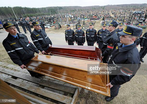 Belarussian policemen carry the lids of the coffins of Galina Pikulik and Anatoliy Narkevich victims of the Minsk metro bombing that killed 12 and...