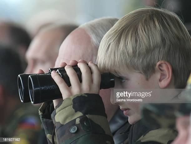 Belarussian President Alexander Lukashenko and his son Nikolai watch joint Russian-Belarussian military exercises at the polygon on September 26,...