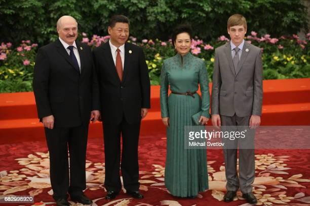 Belarussian President Alexander Lukashenko , his son Nikolai Lukashenko Chinese President Xi Jinping C), his wife Peng Liyan pose for a photo prior...