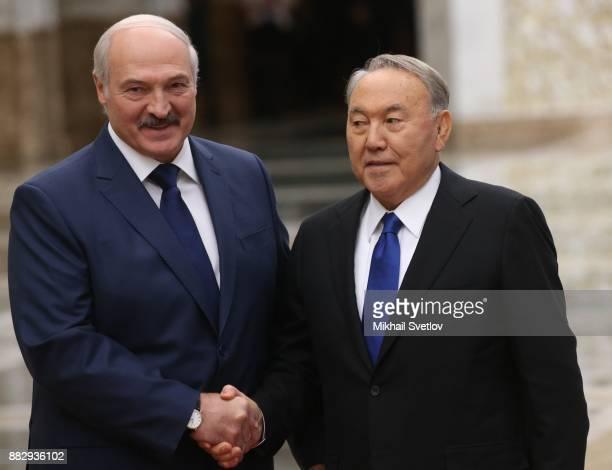 Belarussian President Alexander Lukashenko shakes hands with Kazakh President Nursultan Nazarbayev during the CSTO Summit November 30 2017 in Minsk...