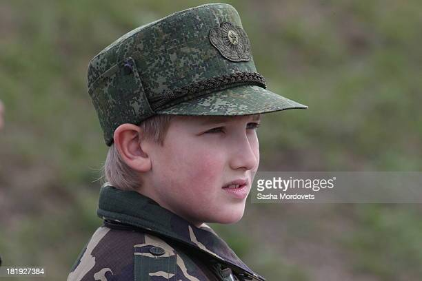 Belarussian President Alexander Lukashenko's son Nikolai watches a joint Russian-Belarussian military exercises at the polygon on September 26, 2013...