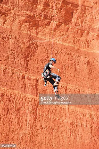 belaying rock climber rappelling cliff face - free climbing stock pictures, royalty-free photos & images