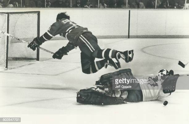A beleaguered Maple Leaf goalkeeper Mike Palmateer was all alone here as he was much of the night fending off a breakaway as he foiled Yvan Cournoyer