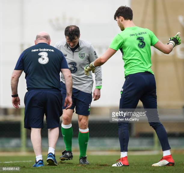 Belek Turkey 20 March 2018 Assistant manager Roy Keane centre equipment manager Dick Redmond and goalkeeper Kieran O'Hara replace pieces of turf...