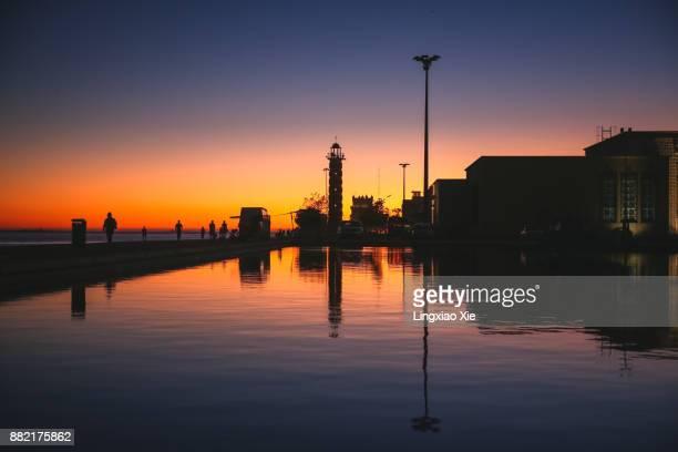Belem Lighthouse at dusk with reflection along Tagus River, Lisbon, Portugal