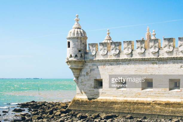 belem tower and the atlantic ocean - castle stock pictures, royalty-free photos & images