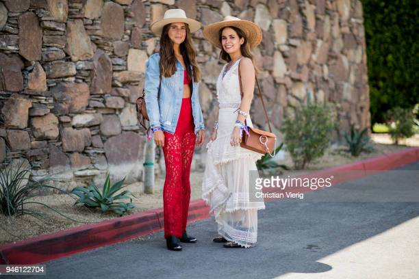 Belen Hostalet and Sara Escudero wearing Chloe bag, House of Harlow dress, straw hat is seen on April 13, 2018 in Indio, California.