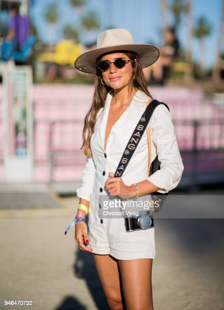 Belen Hostalet wearing hat, jumpsuit, boots is seen at Revolve Festival on April 14, 2018 in Indio, California.