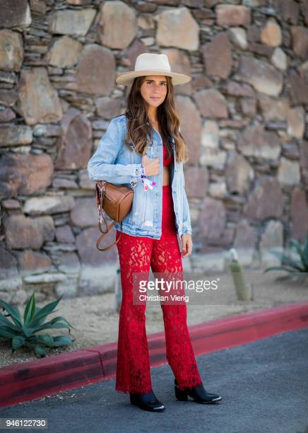 Belen Hostalet wearing straw hat Chloe backpack denim jacket red cropped top and flared pants is seen on April 13 2018 in Indio California