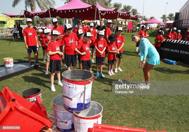 Belen Mozo of Spain gives a demontration to Future Falcon Kids during Day One of the Fatima Bint Mubarak Ladies Open at Saadiyat Beach Golf Club on...