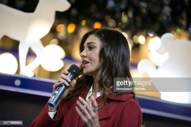 Belen Rodriguez accompanied by her son Santiago, godmother of the ceremony of lighting the Swarovski Christmas tree , in Galleria Vittorio Emanuele....