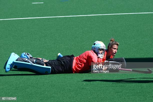Belen Succi Goalkeeper of Argentina and Susannah Townsend of England look at the ball go into the goal during day 9 of the FIH Hockey World League...