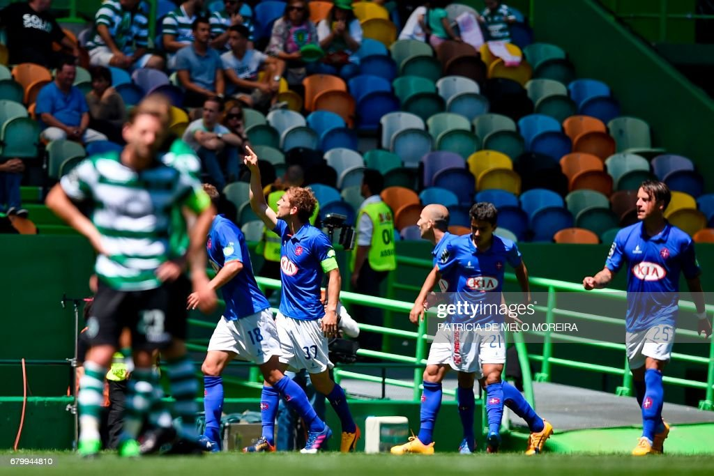 Belenenses' defender Goncalo Silva (4R) celebrates a goal during the Portuguese league football match Sporting CP vs OS Belenenses at the Jose Alvalade stadium in Lisbon on May 7, 2017. /