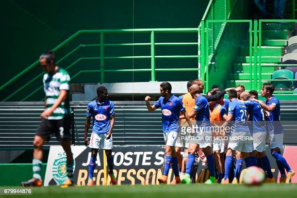 Belenenses players celebrate a goal during the Portuguese league football match Sporting CP vs OS Belenenses at the Jose Alvalade stadium in Lisbon...