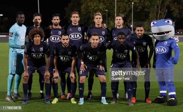 Belenenses SAD players pose for a team photo before the start of the Liga NOS match between Belenenses SAD and FC Pacos de Ferreira at Estadio...