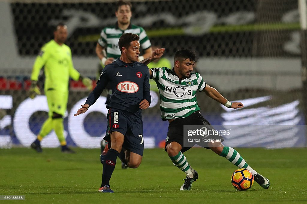 Belenenses's defender Mica Pinto from Portugal (L) vies with Sporting CPO's defender Ricardo Esgaio (R) during the Portuguese Primeira Liga between CFO's Belenenses v Sporting CP - Primeira Liga at Estadio do Restelo on December 22, 2016 in Lisbon, Portugal.