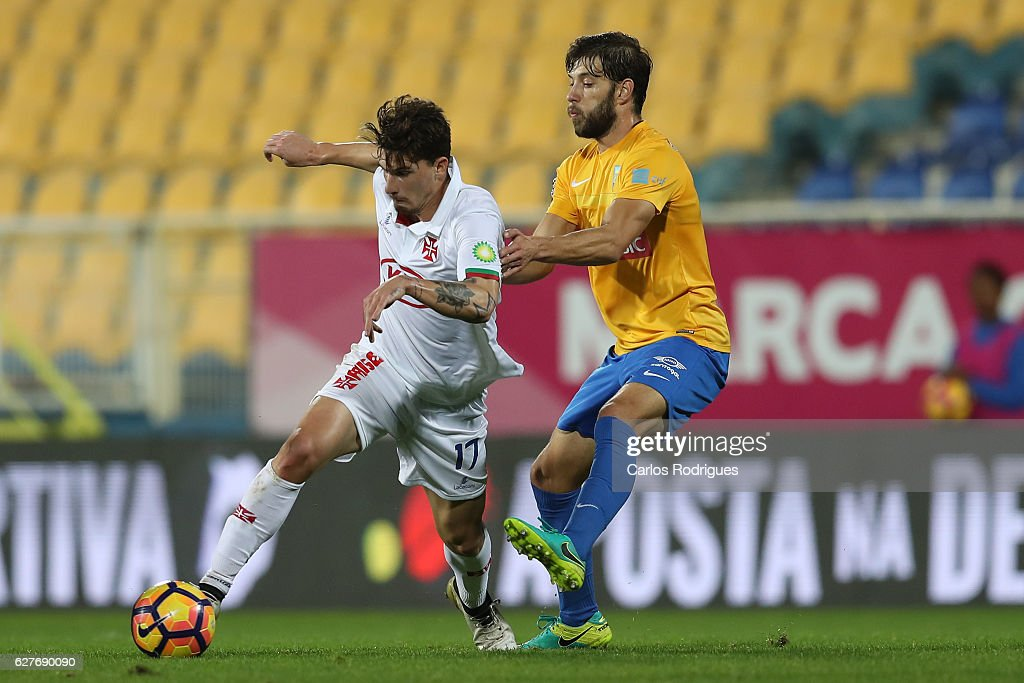 Belenenses's forward Fabio Sturgeon from Portugal (L) vies with Estoril's defender Joel Ferreira from Portugal (R) during the match between Estoril Praia SAD and CF Os Belenenses for the Portuguese Primeira Liga at Estadio Antonio Coimbra da Mota on August 21, 2016 in Lisbon, Portugal.