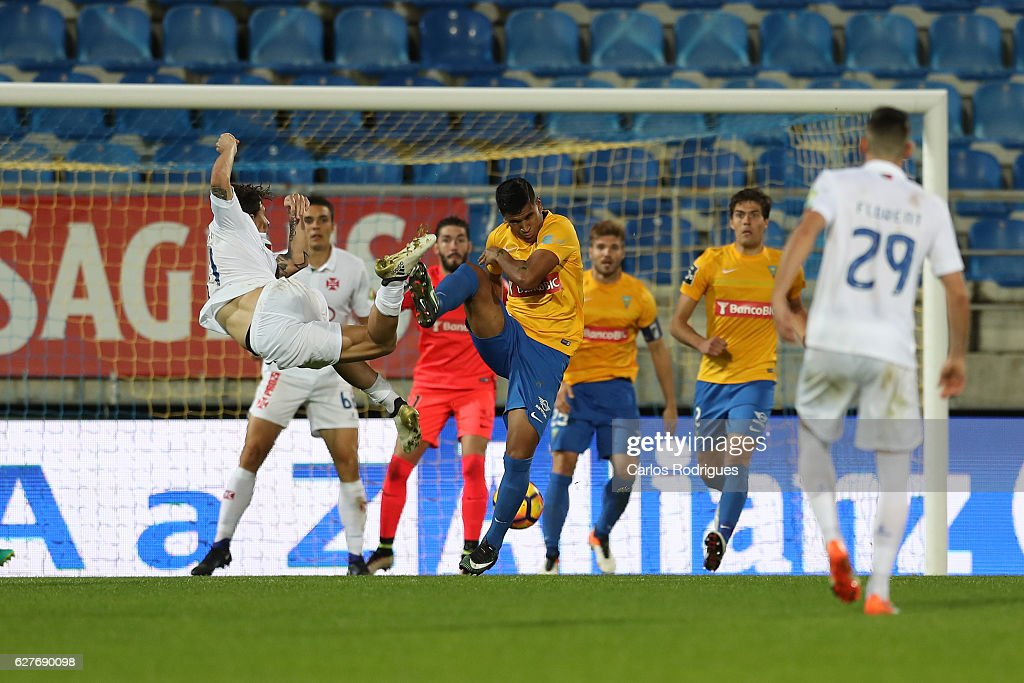 Belenenses's forward Fabio Sturgeon from Portugal (L) vies with Estoril's midfielder Matheus Indio from Brazil (R) during the match between Estoril Praia SAD and CF Os Belenenses for the Portuguese Primeira Liga at Estadio Antonio Coimbra da Mota on August 21, 2016 in Lisbon, Portugal.